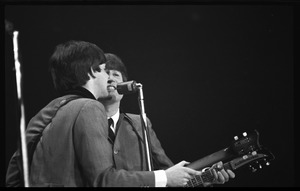 Thumbnail of Paul McCartney and John Lennon performing with the Beatles at the Washington Coliseum