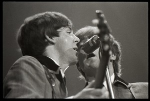 Thumbnail of Paul McCartney and John Lennon harmonizing in concert with the Beatles, Washington Coliseum