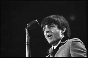 Thumbnail of Paul McCartney at the microphone, in concert with the Beatles, Washington Coliseum