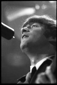 Thumbnail of John Lennon at the microphone, in concert with the Beatles, Washington Coliseum