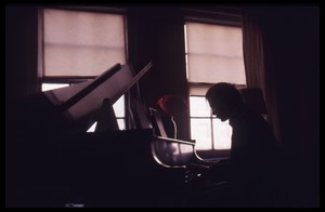 Thumbnail of Stephen Stills playing piano in Judy Collins's apartment