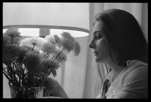 Thumbnail of Judy Collins: portrait in profile with carnations