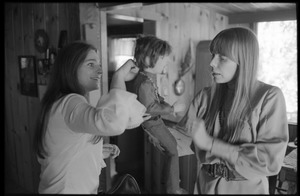 Thumbnail of Joni Mitchell (right) and Judy Collins, playing with a Graham Nash doll at Mitchell's house in Laurel Canyon