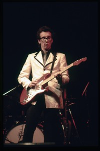 Thumbnail of Elvis Costello and the Attractions in concert: Costello on guitar