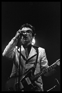Thumbnail of Elvis Costello and the Attractions in concert: Costello on guitar and vocals