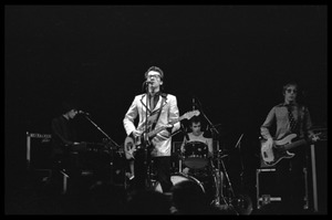 Thumbnail of Elvis Costello and the Attractions in concert: From left: Steve Nieve, Elvis             Costello, Bruce Thomas, Pete Thomas