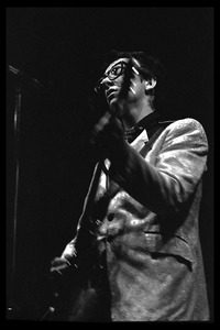 Thumbnail of Elvis Costello and the Attractions in concert: Elvis Costello on guitar