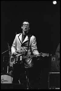 Thumbnail of Elvis Costello and the Attractions in concert: Elvis Costello on guitar and             vocals