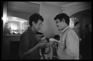 Thumbnail of Bob Dylan talking with unidentified man at a reception, Newport Folk Festival