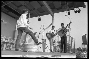 Thumbnail of Jackie Washington (lead guitar) on stage with Fritz Richmond (strong bass) and             Mitch Greenhill, Newport Folk Festival
