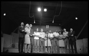 Thumbnail of We Shall Overcome: performers on stage, Newport Folk Festival Left to right: Peter Yarrow, Mary Travers, Paul Stookey, Joan Baez, Bob Dylan,             Bernice Reagon, Cordell Reagon, Charles Neblett, Rutha Harris, Pete Seeger, and Theodore             Bikel