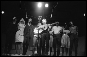 Thumbnail of Bob Dylan leading performers on stage, Newport Folk Festival Left to right: Peter Yarrow, Mary Travers, Paul Stookey, Joan Baez, Bob Dylan,             Bernice Reagon, Cordell Reagon, Charles Neblett, Rutha Harris, Pete Seeger