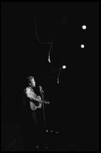 Thumbnail of Bob Dylan performing on stage, Newport Folk Festival