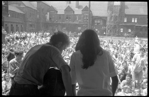 Thumbnail of Bob Dylan and Joan Baez finishing their set on Porch #1, Newport Folk Festival View from stage right, with stands in the background