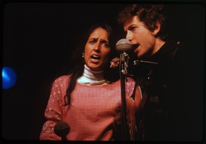 Thumbnail of Bob Dylan and Joan Baez, performing on stage, Newport Folk Festival