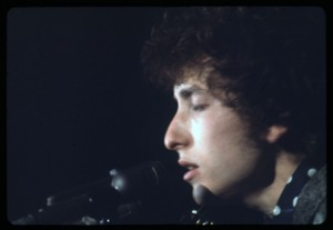 Thumbnail of Bob Dylan performing on stage, close-up at the microphone Dylan in concert at the Washington Coliseum