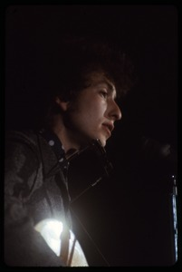 Thumbnail of Bob Dylan performing on stage Dylan in concert at the Washington Coliseum