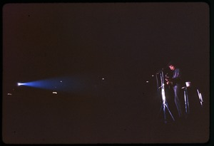 Thumbnail of Bob Dylan performing on stage: long shot in the spotlight Dylan in concert at the Washington Coliseum