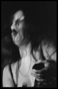 Thumbnail of Janis Joplin performing at Woodstock Close-up portrait at the microphone