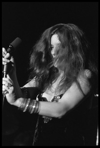 Thumbnail of Janis Joplin performing at Woodstock Half-length portrait at the microphone