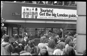 Thumbnail of Police lining up in font of a double decker bust during a demonstration against             the prosecution of Oz Magazine editors on charges of obscenity