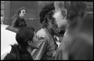 Thumbnail of Yoko Ono at a demonstration against the prosecution of Oz Magazine editors on charges of             obscenity, begins to march with John Lennon (partl obscured) and others