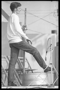 Thumbnail of Fritz Richmond on stage, playing washtub bass, Newport Folk Festival