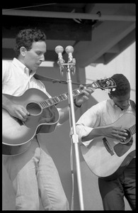 Thumbnail of Mitch Greenhill (left) and Jackie Washington performing on stage, Newport Folk Festival