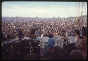 Thumbnail of Jefferson Airplane performing at Woodstock, with audience in background