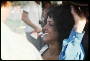 Thumbnail of Grace Slick (Jefferson Airplane) seated off stage at the Woodstock Festival
