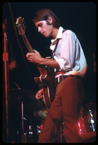 Thumbnail of Bob Weir (Grateful Dead) performing on guitar at the Woodstock Festival