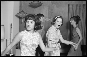 Thumbnail of Teenage long hair: teenage girls at a dance party held in a room decorated in             mid-century modern style