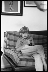 Thumbnail of Teenage long hair: young boy watching the dance party from a couch, Coca Cola in         hand