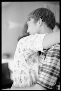 Thumbnail of Teenage long hair: teenaged girl and long-haired boy embrace