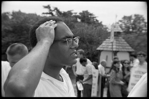 Thumbnail of Robert Parris Moses scratching his head as the march gathers