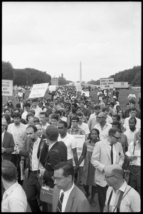Thumbnail of Marchers on the National Mall carrying anti-war signs, heading toward the U.S.             Capitol building (Washington Monument in the background) Robert Parris Moses visible at head of the pack, just behind the newsman
