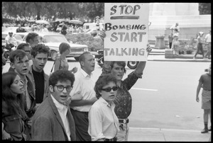 Thumbnail of Assembly of Unrepresented People protesters during anti-war march, one carrying             a sign reading 'Stop bombing, start talking'