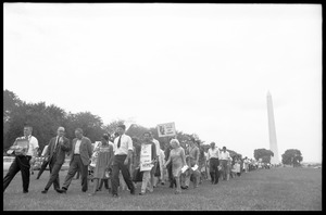 Thumbnail of Marchers on the National Mall carrying anti-war signs, heading toward the U.S.             Capitol building (Washington Monument in the background) David Dellinger (front left) being interviewed by news media and Staughton             Lynd (front right) at head of march