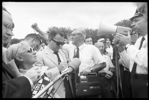 Thumbnail of News media and officer with a bullhorn during peace march in Washington