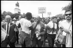 Thumbnail of Unidentified man tending to David Dellinger after he was attacked with red paint by right wing             counterprotesters (a paint-smeared Staughton Lynd stands to right of Dellinger): Assembly of Unrepresented People peace march on Washington