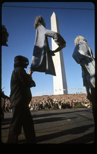 Thumbnail of Performers from Bread and Puppet Theater in death's head masks march past the Washington Monument: Washington Vietnam March for Peace