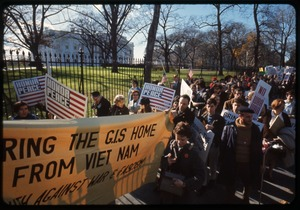 Thumbnail of Antiwar protesters march past the white house with a banner reading 'Bring the             GIs home from Viet Name' and signs reading 'Honor peace': Washington Vietnam March for Peace
