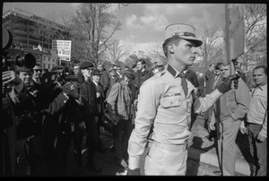 Thumbnail of American Nazi Party counter-protester Douglas L. Niles, in uniform, walking away from news media: sign in background reads 'Beatniks,             Vietniks, sedition mongers, and all other assorted traitorous cowardly scum, drop dead             twice': Washington Vietnam March for Peace