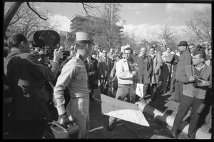 Thumbnail of American Nazi Party counter-protester Douglas L. Niles, in uniform, walking past media and onlookers: Washington Vietnam March for Peace