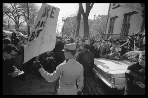 Thumbnail of American Nazi Party counter-protester Douglas L. Niles, in             uniform, holding up a sign for the crowd: Washington Vietnam March for Peace