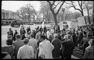 Thumbnail of Counter-protesters in front of the White House across the street from the antiwar demonstration, carrying signs reading 'Students Wildly Indignant About Nearly Everything'         [SWINE], 'We support US policy,' and 'They scream injustice and thus apease their cowardice': Washington Vietnam March for Peace
