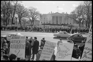 Thumbnail of Counter-protesters in front of the White House across the street from the             antiwar demonstration, carrying signs reading 'They in the name of freedom cry             loudly...' and 'We  SWINE demand removal of all troops no later than 11:28 am 11-28-1965': Washington Vietnam March for Peace