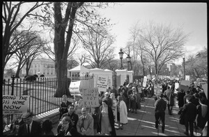 Thumbnail of Protesters outside the White House marching against the war in Vietnam, carrying         signs reading 'Thou shalt not kill;' 'US said no in '64 though Hanoi knocked at UN door;'         and 'Vietnam no, freedom yes, LBJ stop now': Washington Vietnam March for Peace