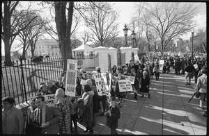 Thumbnail of Protesters outside the White House marching against the war in Vietnam, carrying         signs demanding return of the troops and end to war: Washington Vietnam March for Peace