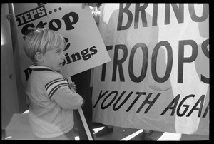 Thumbnail of Protesters marching against the war in Vietnam: a young child carrying an             anti-war sign: Washington Vietnam March for Peace